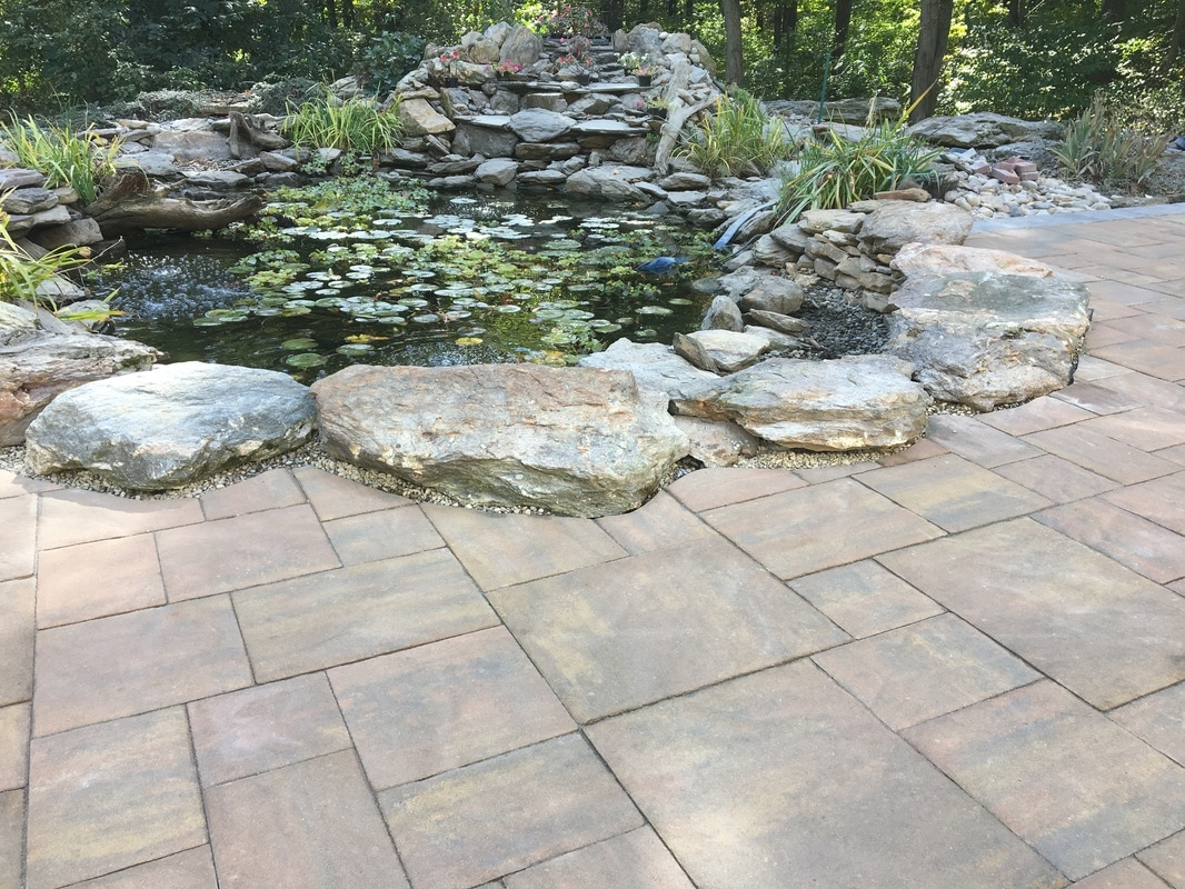 patio-with-stone-boarder_orig.jpg