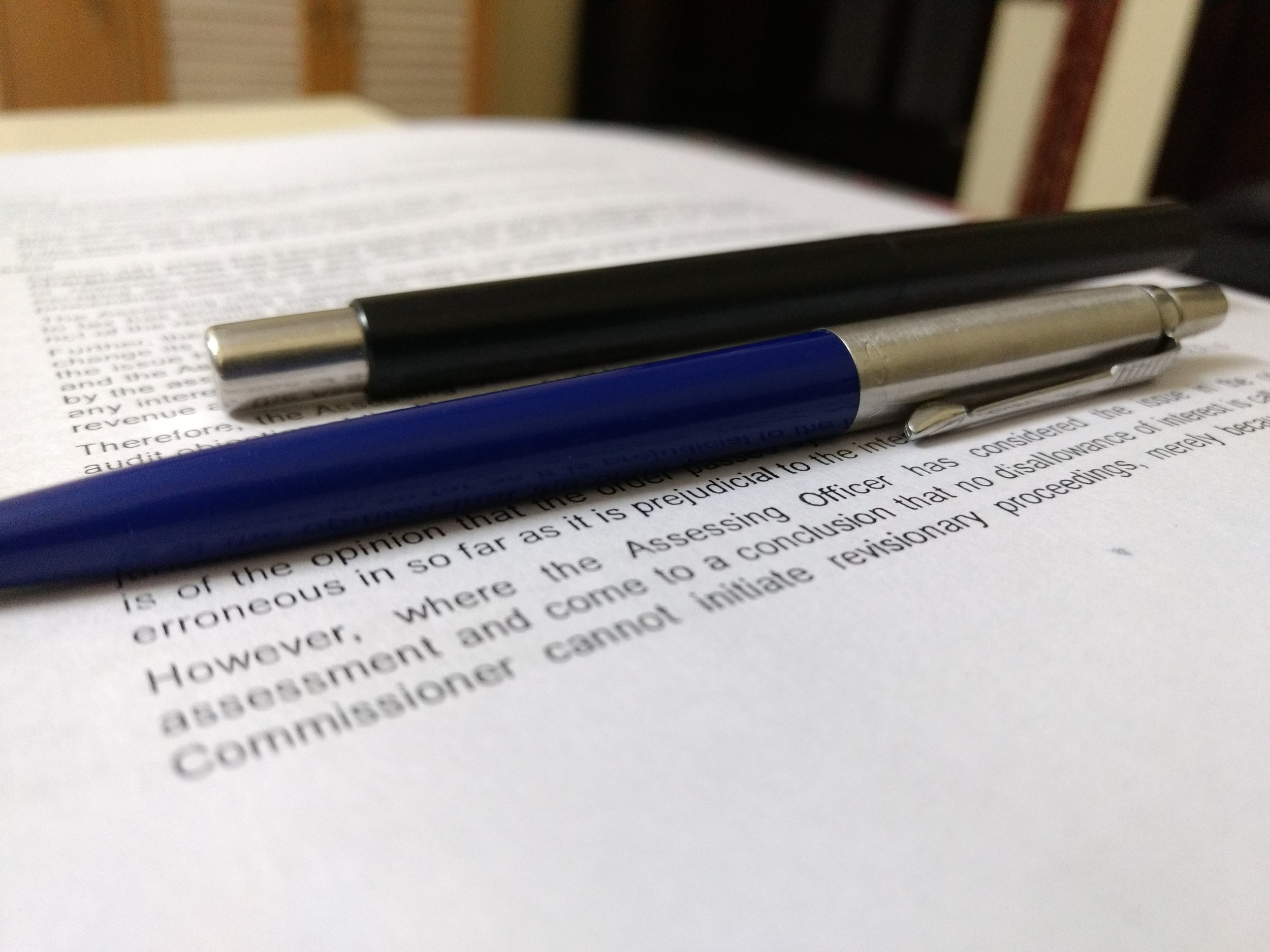 pen and documents in employment agreement post