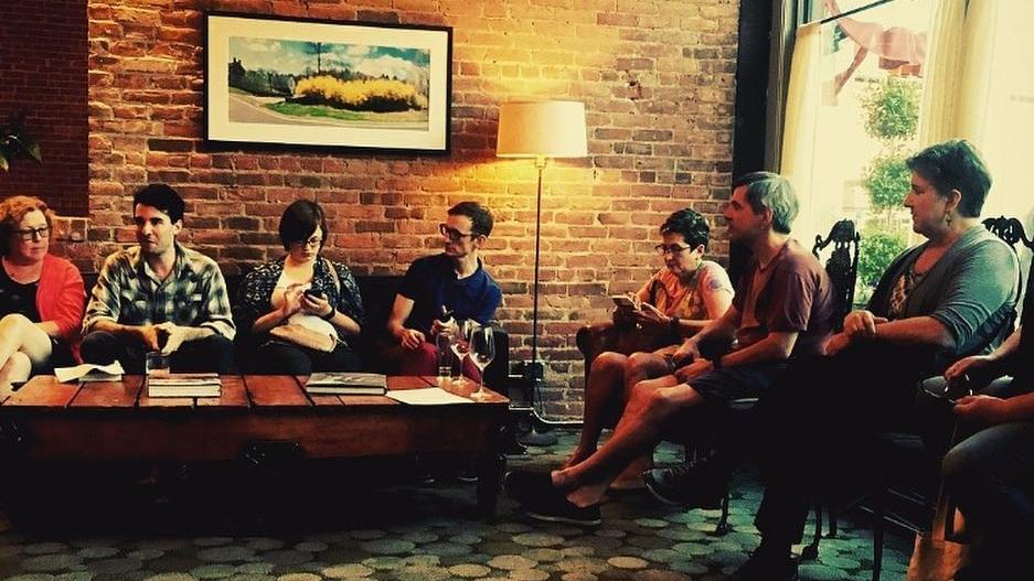 Book Club meeting in exposed brick bar