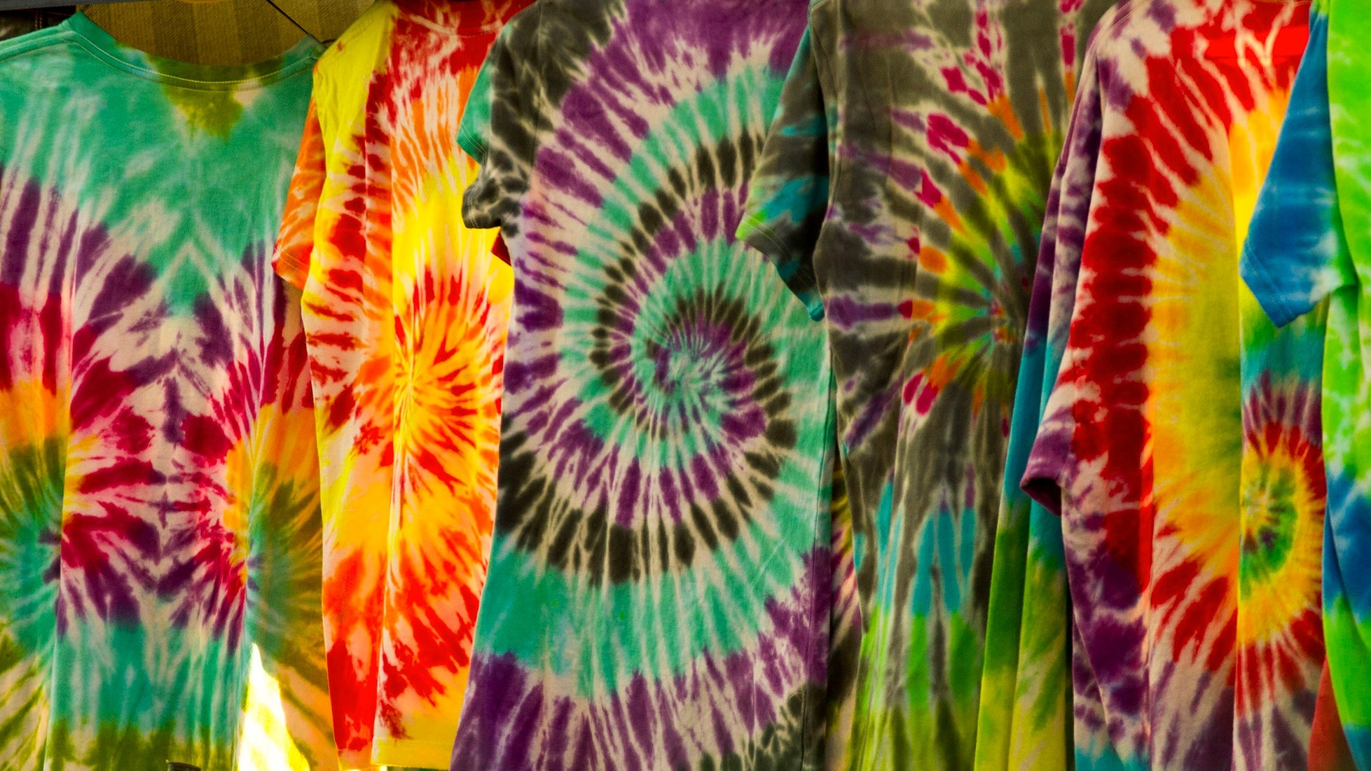 multi-colored tie dyed shirts