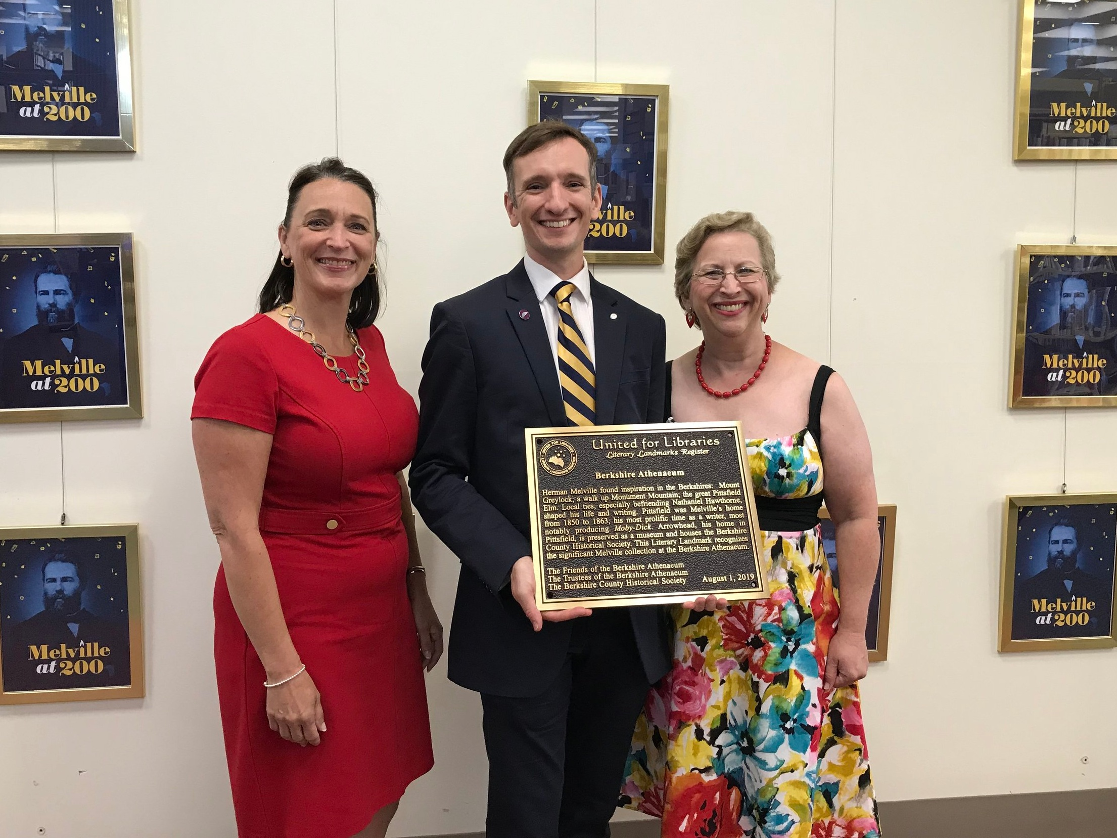 Pittsfield Mayor Linda Tyer, Berkshire Athenaeum Director Alex Reczkowski, and Friends of the Berkshire Athenaeum President Amy Chin with the Literary Landmark plaque