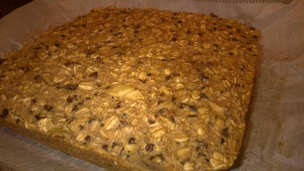 Oat bars hot and fresh from the oven, cooling on the counter before slicing. October 5, 2014.
