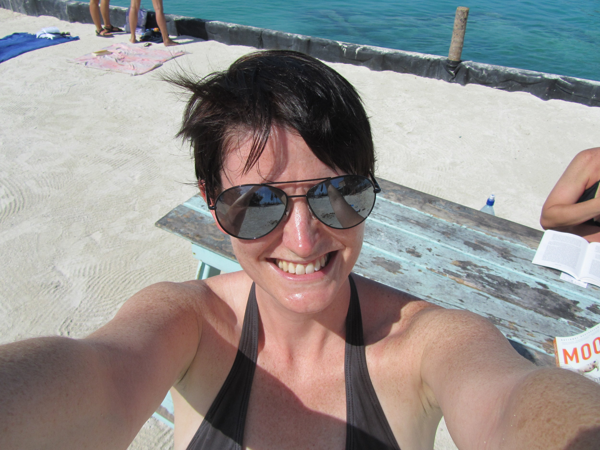 Me in Caye Caulker, Belize. My travel buddy is in the background, at the table. December 2012.