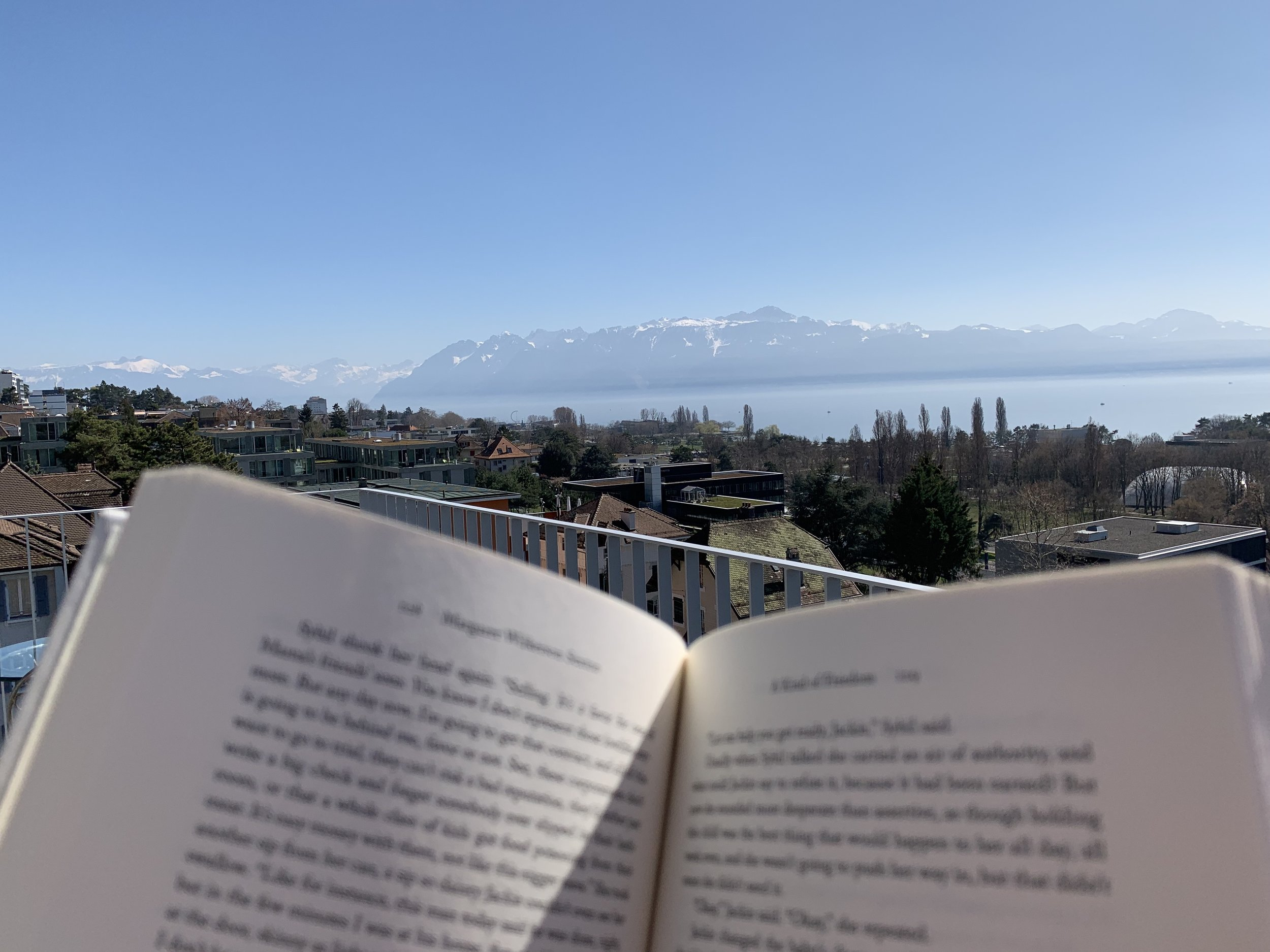 Reading on the terrace. Lausanne, Switzerland, March 2019.