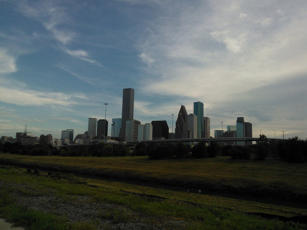 View of downtown Houston's skyline from a nearby bike trail. August 2012.