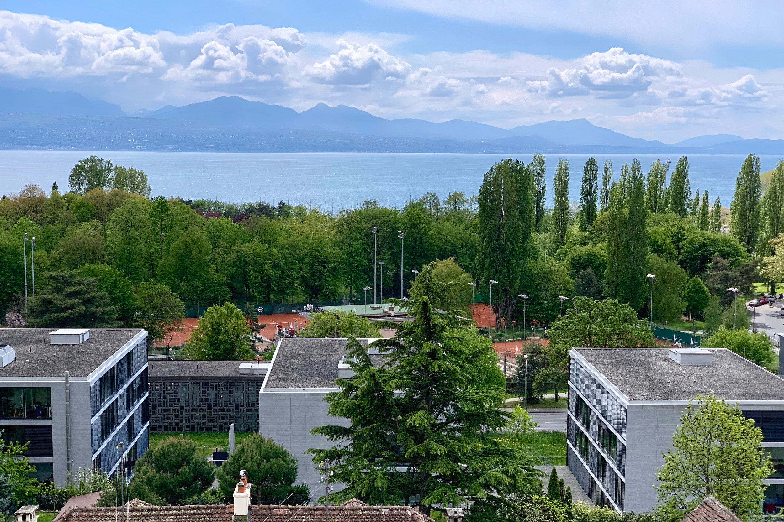 Clay-court tennis, as viewed from my terrace, as I wrote this post. Lausanne, Switzerland. May 3, 2019.