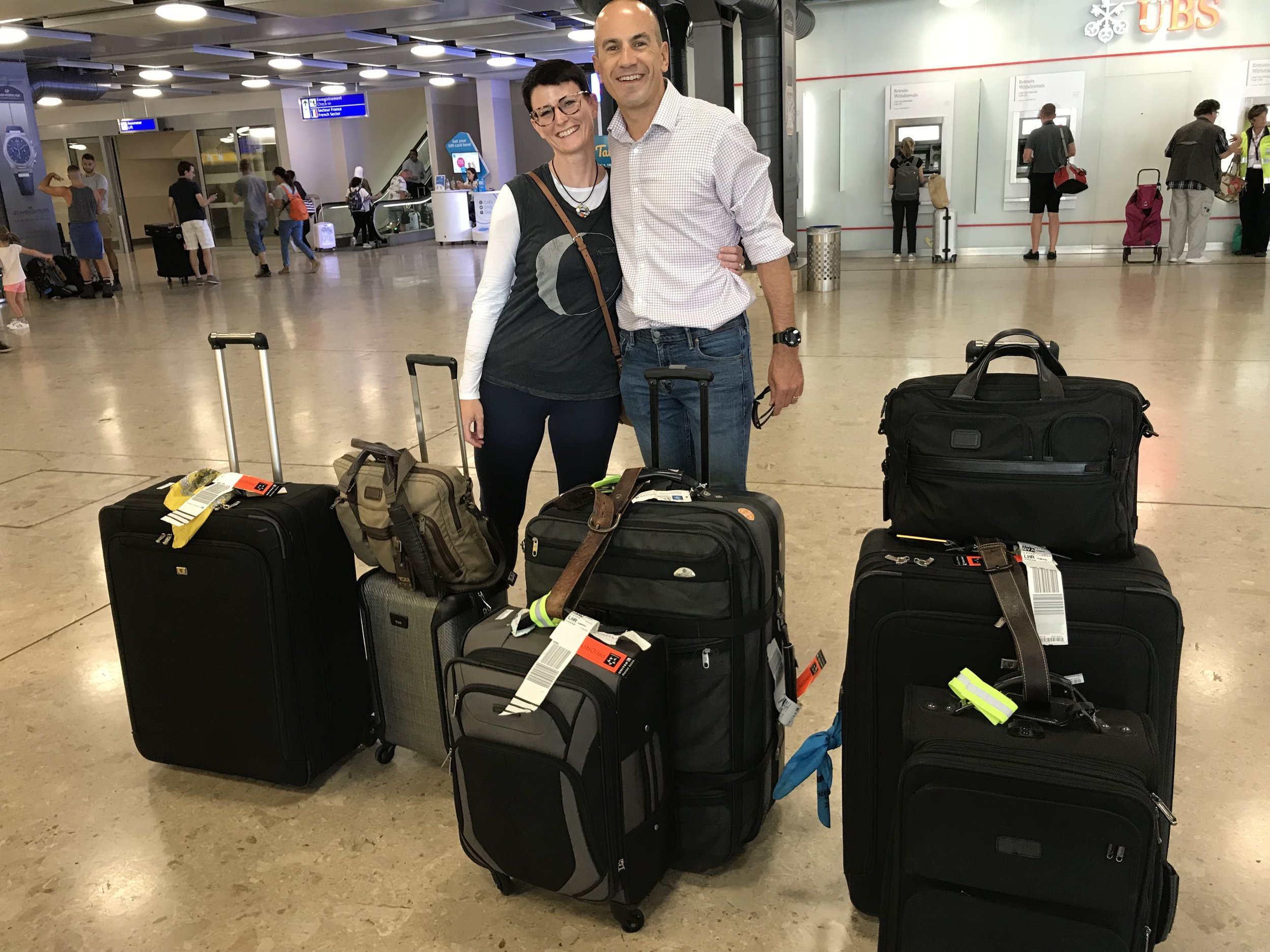 Leslie and Arnaud upon arrival at Geneva Airport on our first day as residents of Switzerland. August 24, 2019.