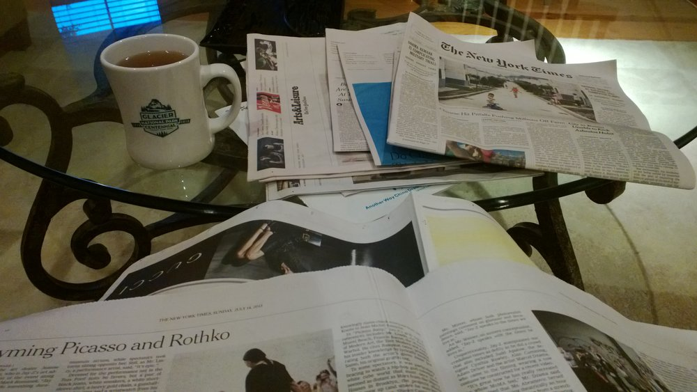 Me reading  The New York Times  and sipping tea. July 14, 2013.