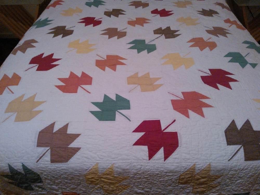 A maple-leaf-pattern quilt hand pieced and hand quilted by my great-grandmother, Hazel Revis.