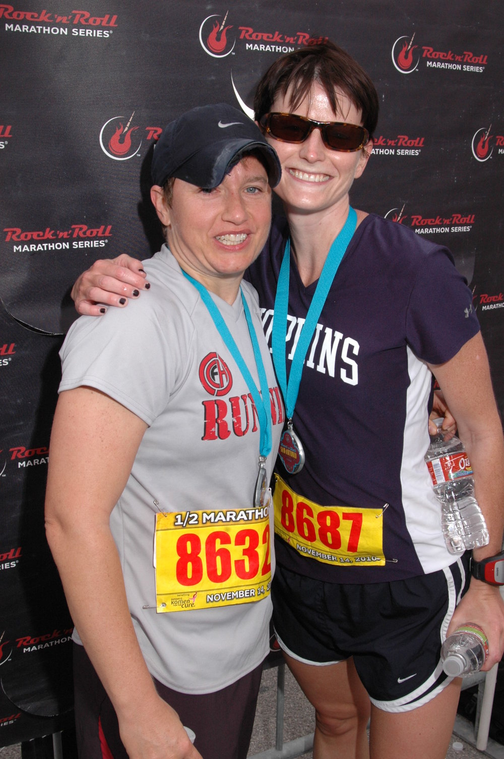 One of my closest friends and I looking like a complete disaster after I paced her to a personal best in the 2010 San Antonio Half Marathon.