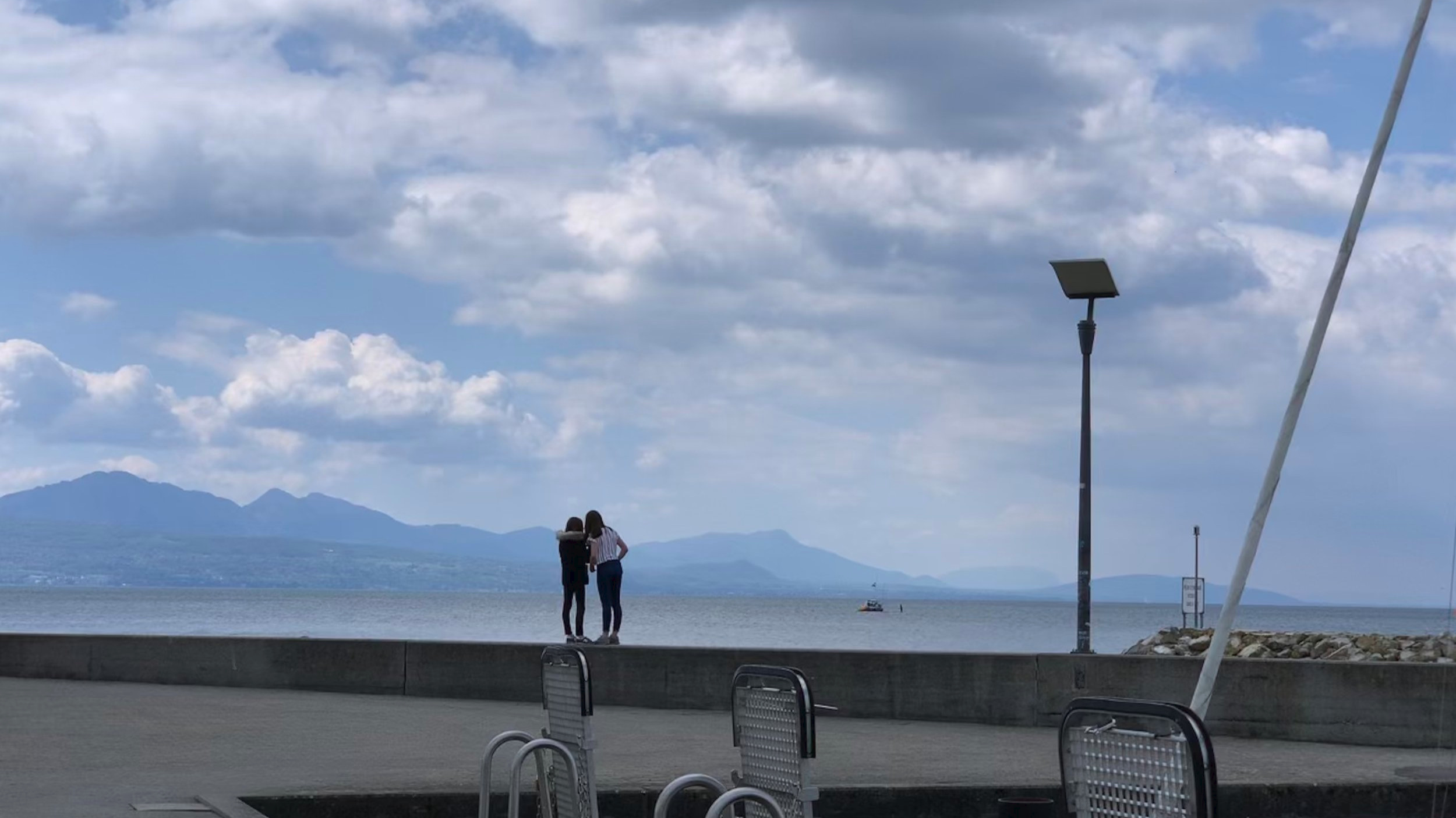 Two friends looking at Lake Geneva. Ouchy, Lausanne, Switzerland. May 12, 2019.