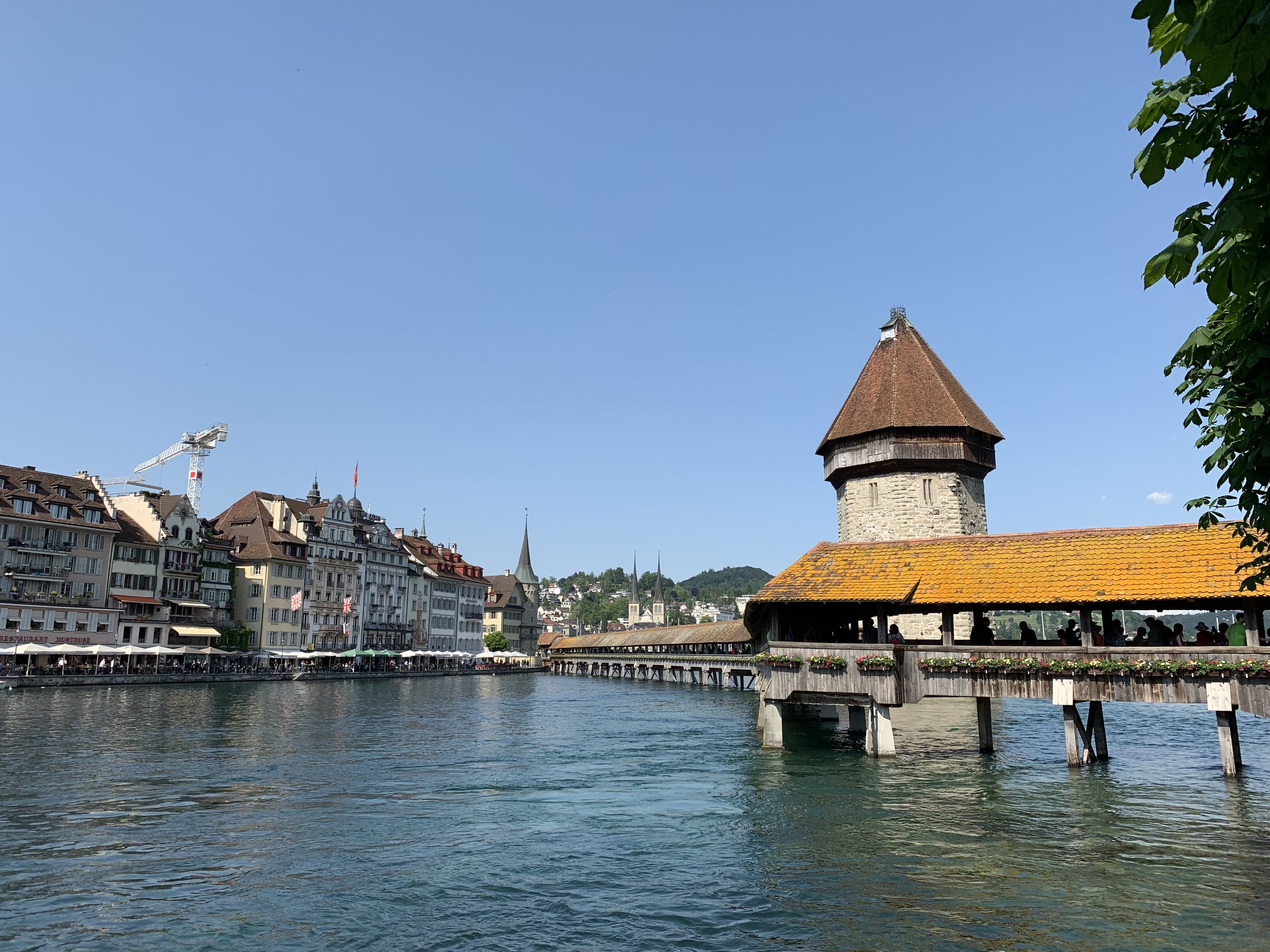 A view of old town Lucerne and the Kapellbrücke from a Reuss River bank. June 4, 2019.
