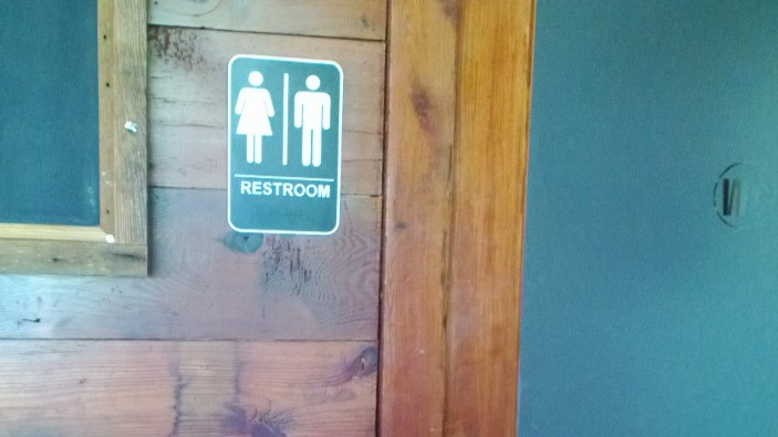 The sign leading to the bathrooms at Revival Market in Houston. March 2013.