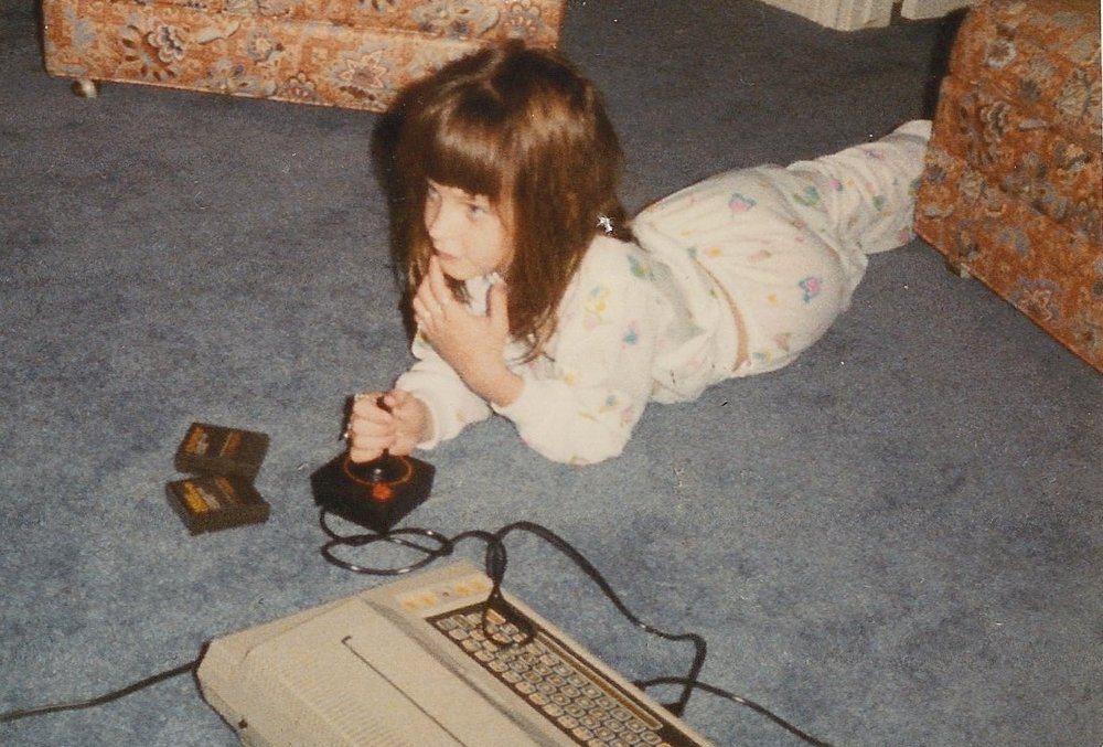 Me playing Pac-Man at about the same age and in about the same belly-flop position I would have read and written past lights-out. (No one caught a photo of that.) c. 1980