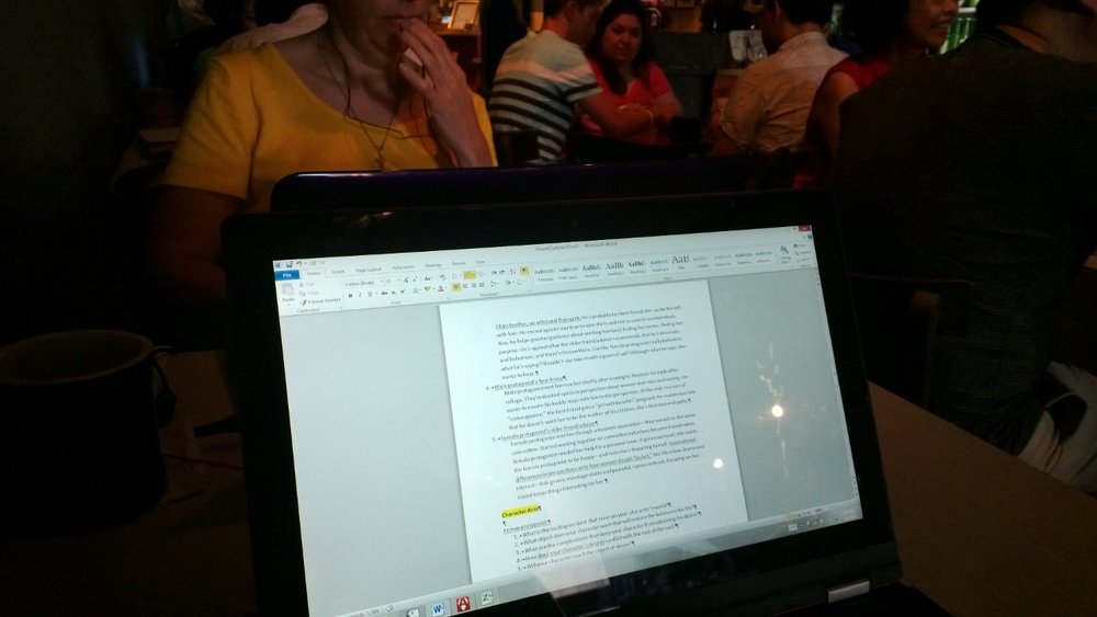 My friend and me at Boomtown Coffee in Houston, writing in tandem. July 6, 2013.