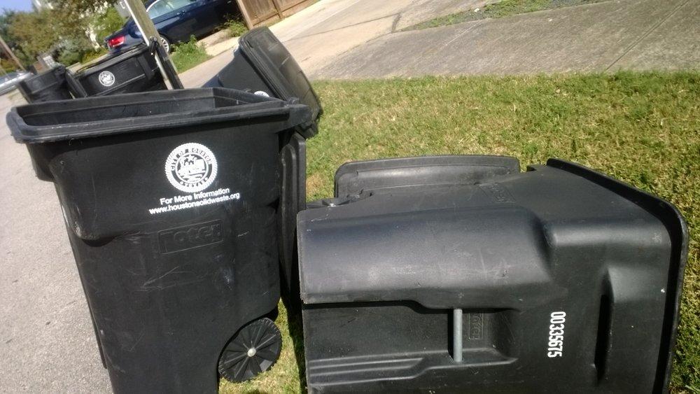 Trash cans at the end of trash day. Houston. November 18, 2013.