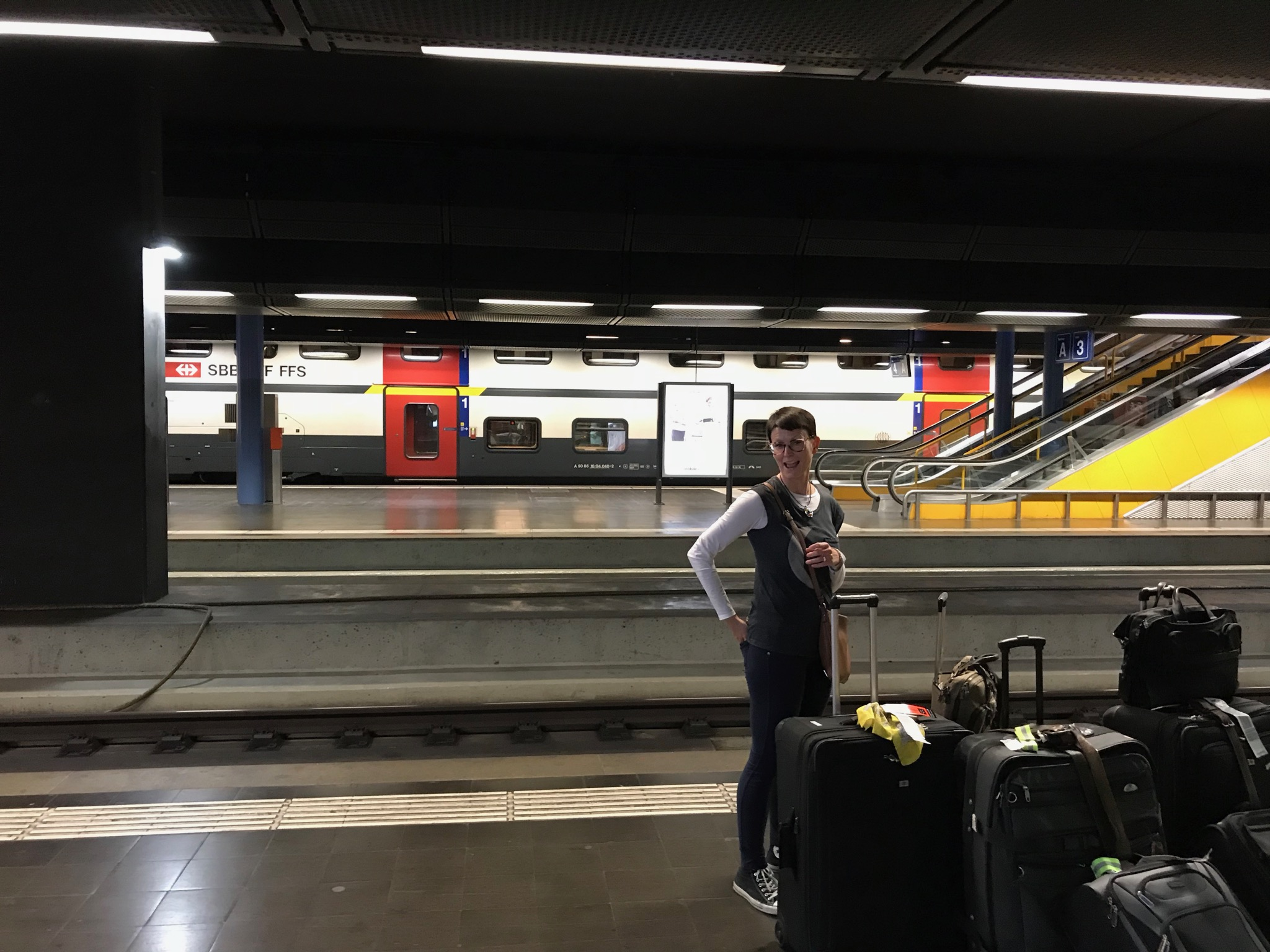 At the Geneva Airport train station with all our luggage, waiting for the train to Lausanne. August 25, 2018.