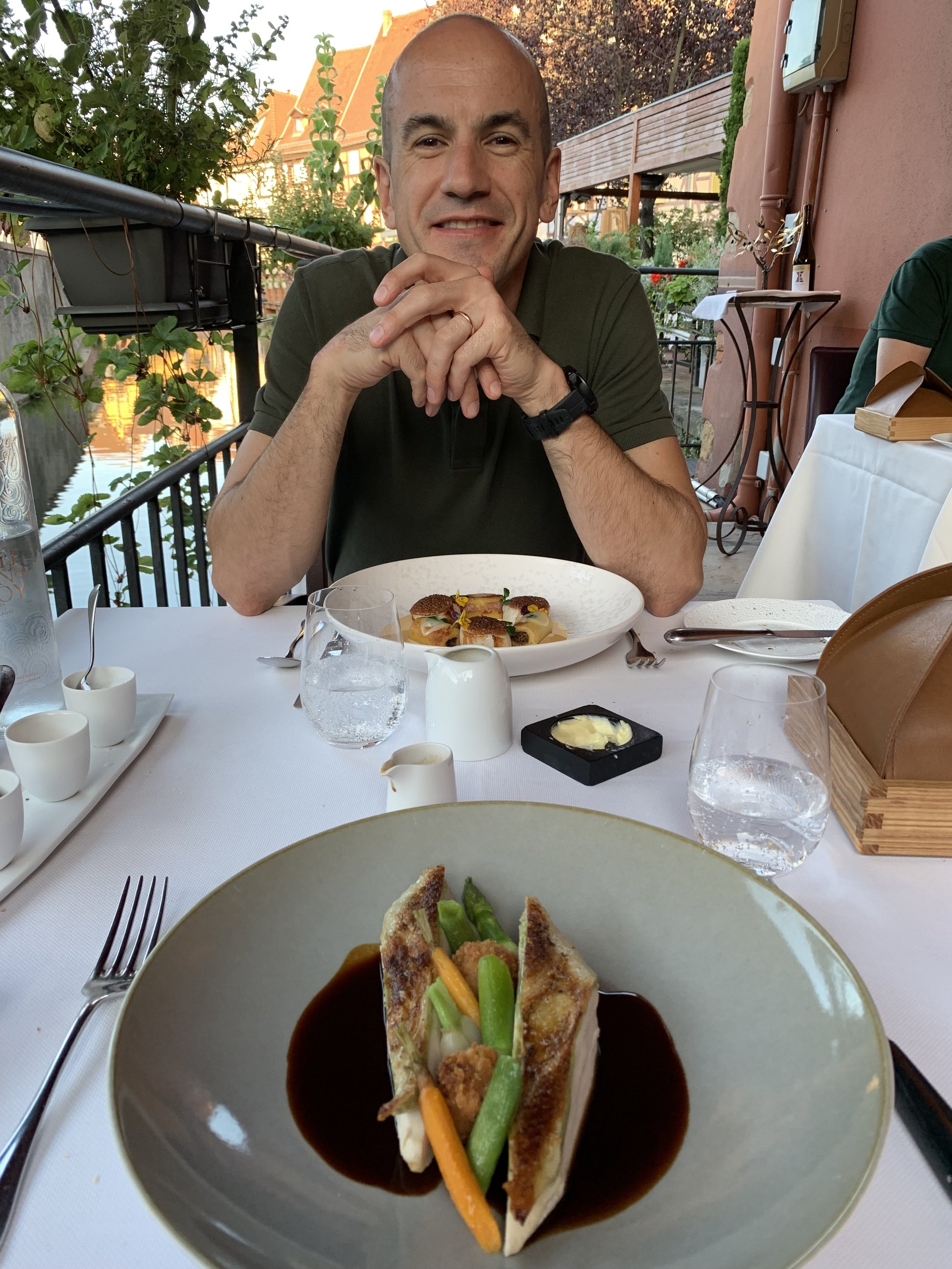 The birthday boy with our main courses at dinner on the terrace at JY's. Colmar, France. August 10, 2019.