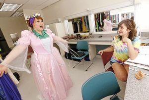 Costume Designer, Meagan Ferguson, and her apprentice, Reid Patten, work on a costume design.