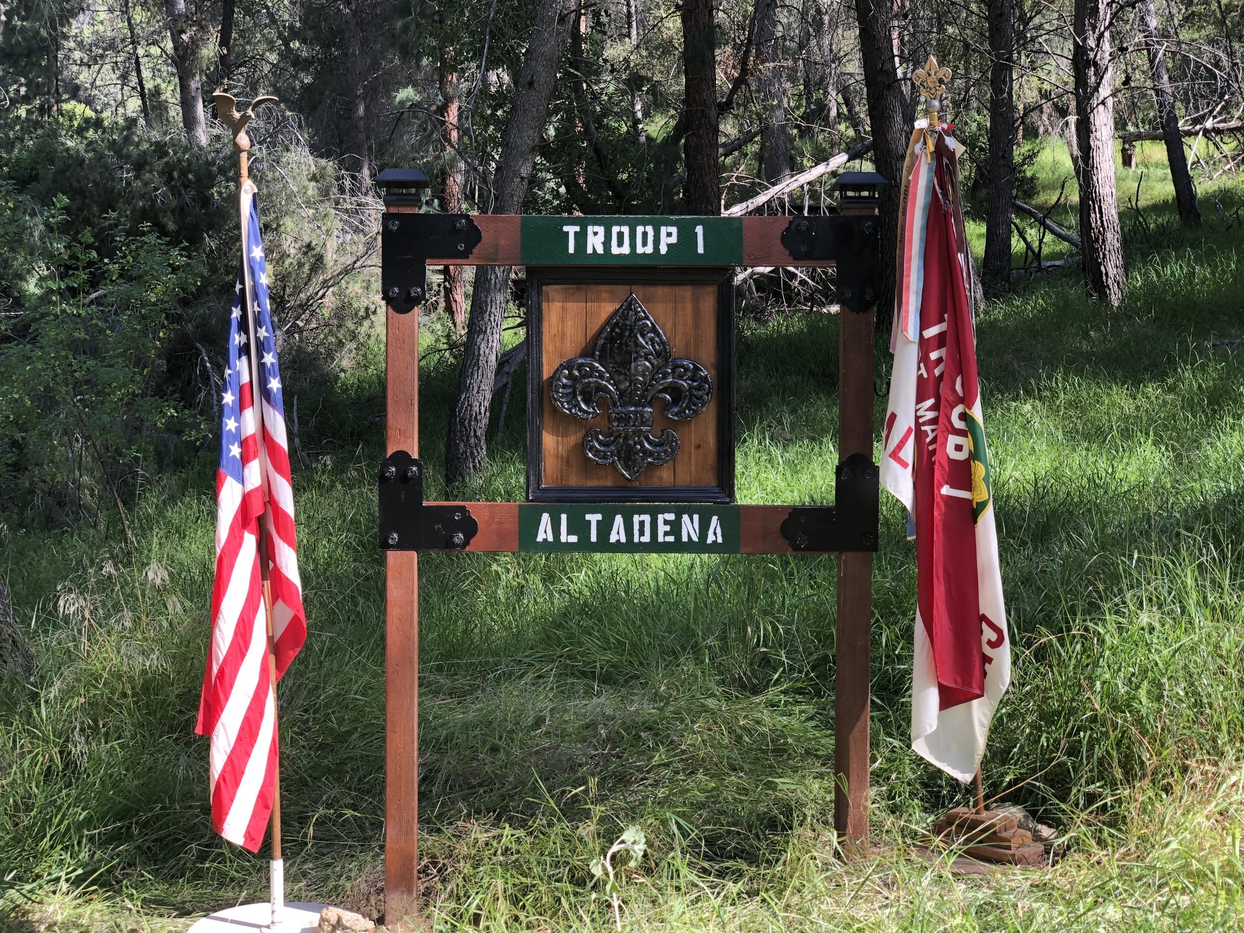 A new Troop 1 sign was assembled and installed to mark Troop 1's new area at Camp Trask following several weeks of effort. The Troop also received a Camporee award for most improved camp area!