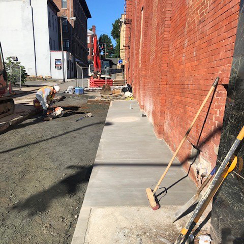 Pouring a new sidewalk on 11th St.