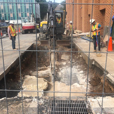 Excavation of the old underground electrical vault near the intersection of 10th St. and Main St.