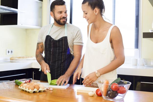couple-cutting-vegetable-kitchen_23-2147892111.jpg