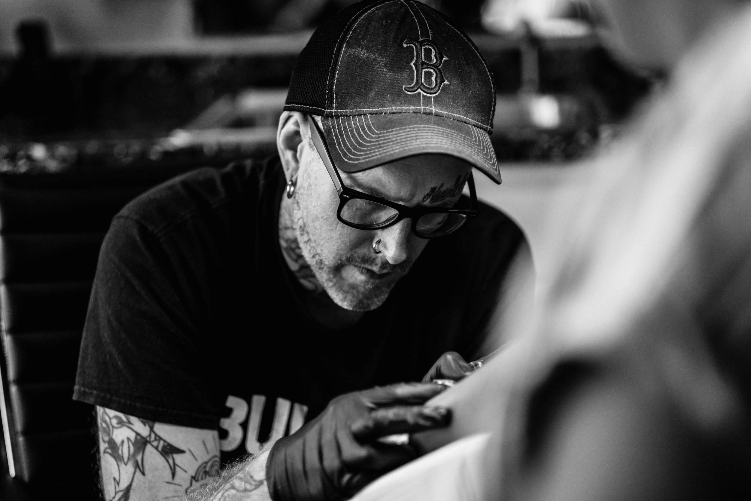 Aaron Marco- 25+ years experience - Owner of Marco's Tattoo and tattooer with over 25 years of experience. He specializes in black and grey realism and cover up work.