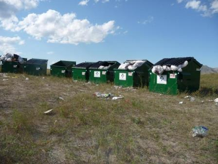 Overflowing dumpsters placed by Bear Butte