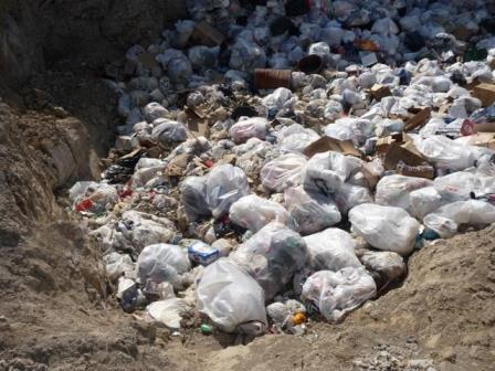 Mountains of trash illegally disposed of around Bear Butte sacred site