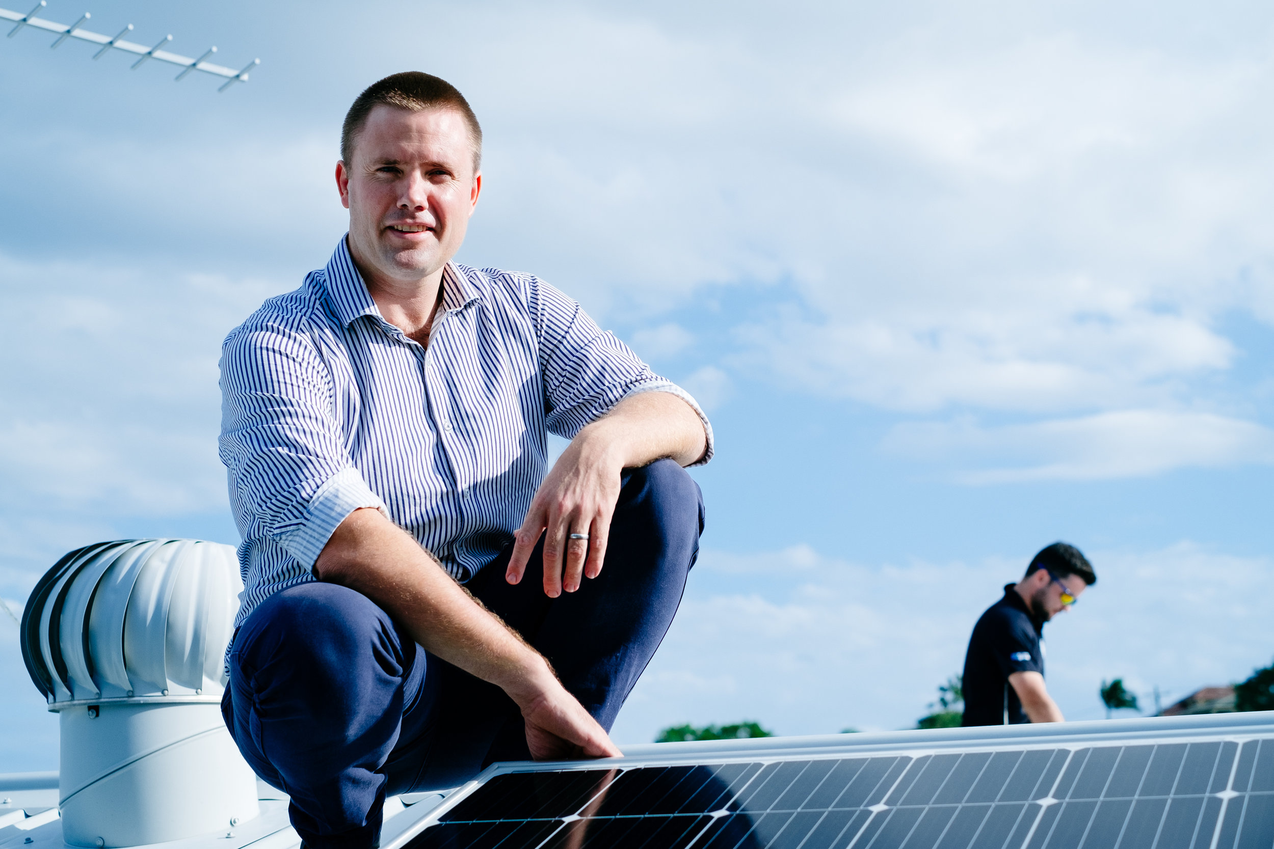 Spinfiex Energy owner Tom Warriner inspecting a solar power panel installation at a client's home in Balmoral, Brisbane.