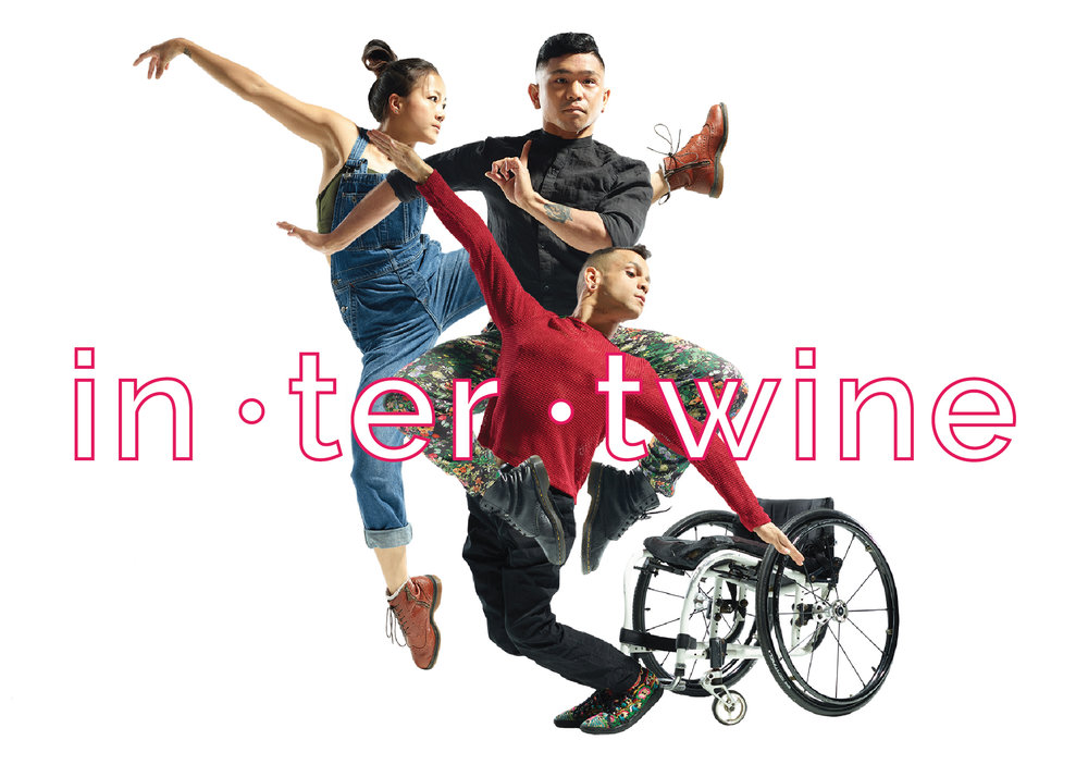 An image of three dancers intertwined physically, jumping and balancing while posing for the camera with one dancer's wheelchair in the background