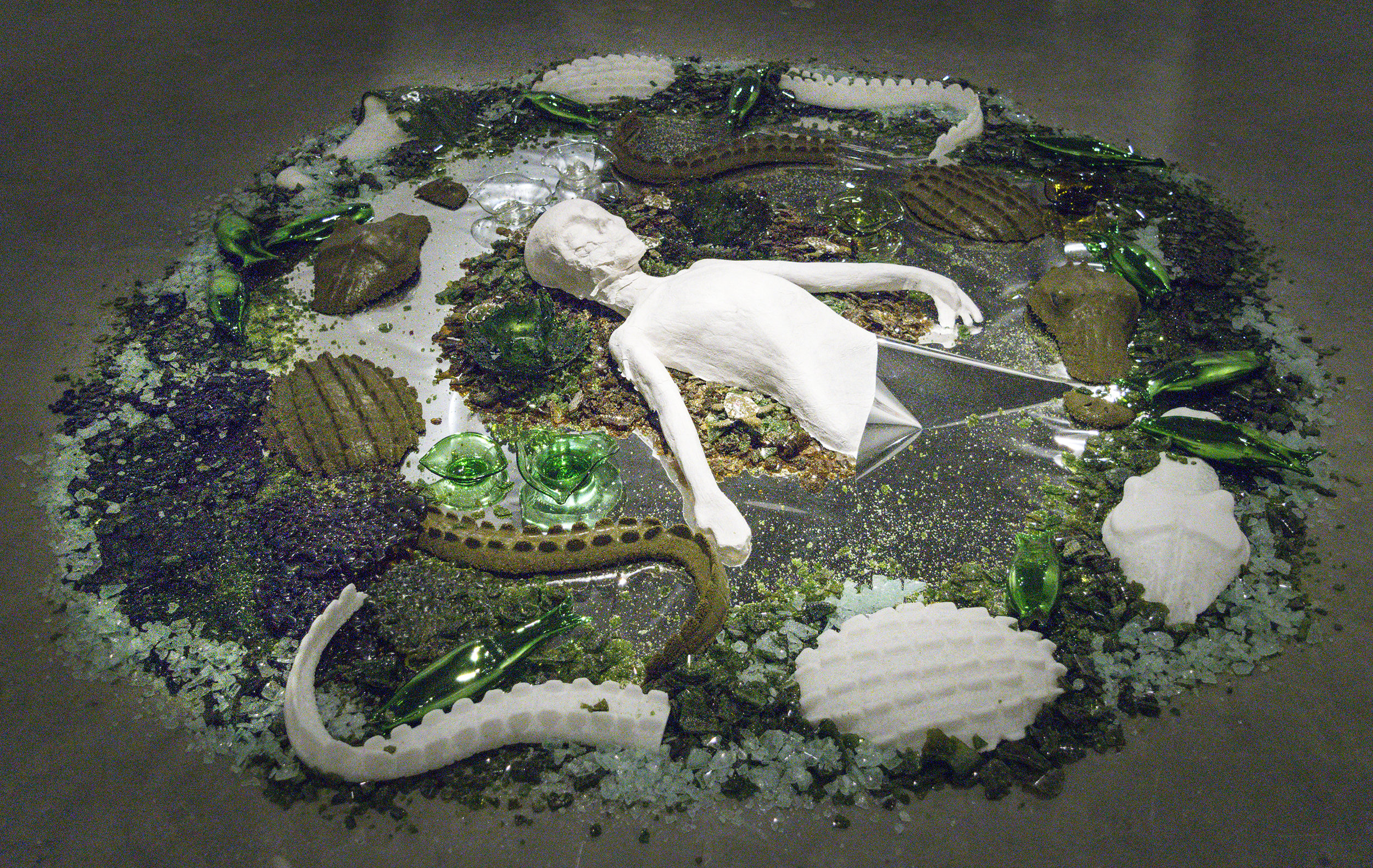 """American Owned Family Operated  2016  Blown, kiln cast, fused, slumped, crushed, bottle glass, abaca paper, mylar  48""""d, variable height"""