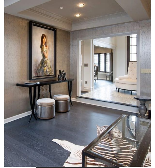 """Thank you @carlislewideplankfloors for featuring our custom project on your site!! It was a wonderful experience to collaborate and design this custom flooring for our client! As highlighted: """"This floor features a stunning paradox between the traditional nutty, brown hues of White Oak, contrasted against the undulating blue and gray tones of a custom stain. For more than 25 years, Pittsburgh based, Denham-Vitalie Design LP, has been one of the most respected and visionary design firms in the United States. The designers worked with their Wide Plank Specialist to bring an ordinary wood floor, to extraordinary, for this unique pop culture-infused estate that paid homage to the likes of Elvis Presley, Marilyn Monroe, and Alice in Wonderland."""" #denhamvitaliedesigns #customdesign #interiordesigner"""