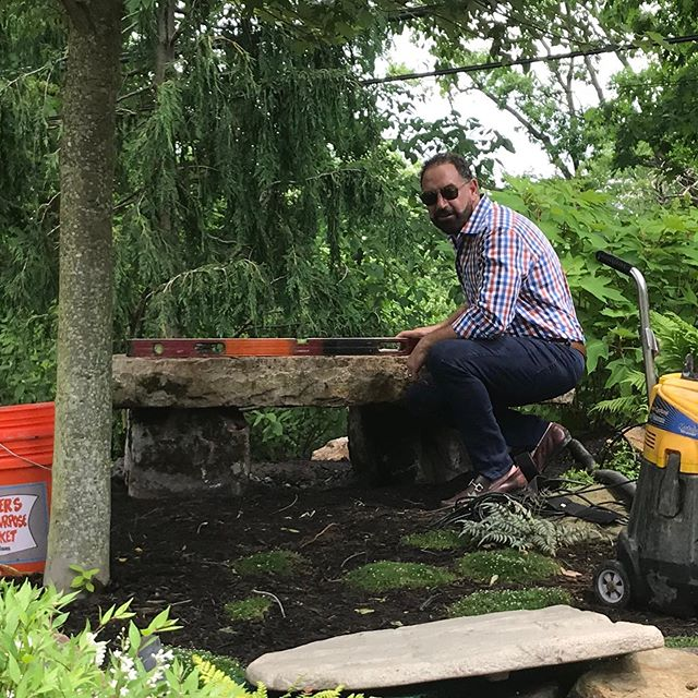 Boulder rock bench install in progress! Each rock was hand selected by Denham-Vitalie. Dan was inspired to add a bench near the coy pond so that it blends when looking at the rest of the topography. Thank you to our crew to lift these massive rocks! #denhamvitaliedesigns #landscapedesign #exteriordesign