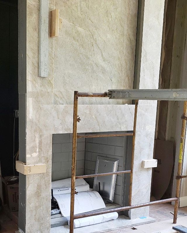 A lot of projects are in progress! Here is a glimpse of a client's master sitting room custom quartzite fireplace going in! #interiordesigner #masterbedroom #fireplace