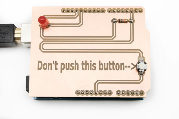 """Don't push this button"" fritzing on PCB board milled on the Bantam Tools Desktop PCB Milling Machine."