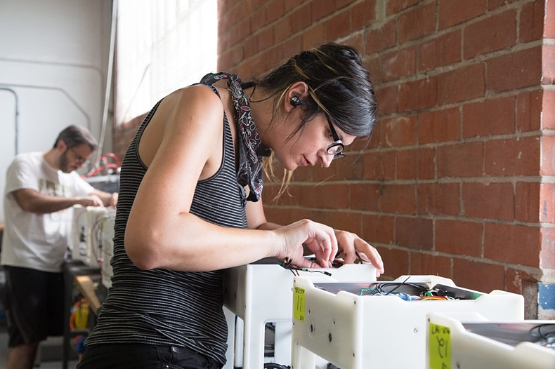 Kim building the Bantam Tools Desktop PCB Milling Machine