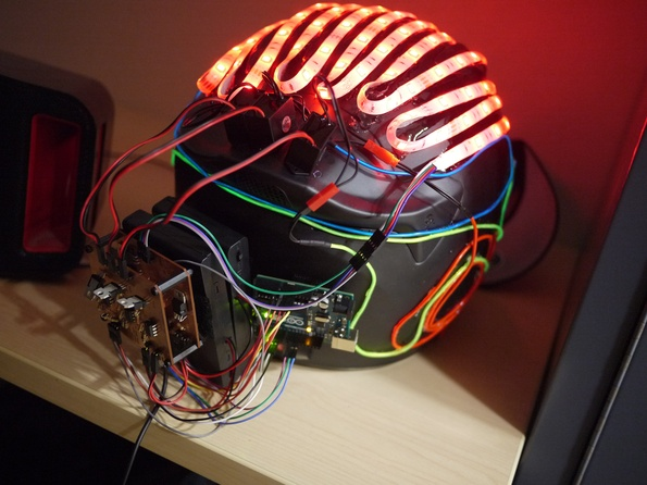 Cal Maritime students made this LED and EL wire helmet that lights up different segments based on the frequency content of the music.