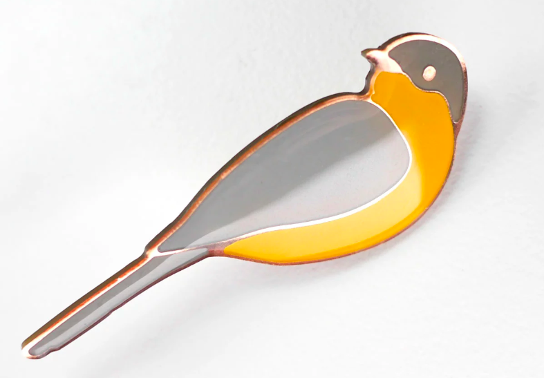 Collin Cunningham's custom bird pin is ready to wear!