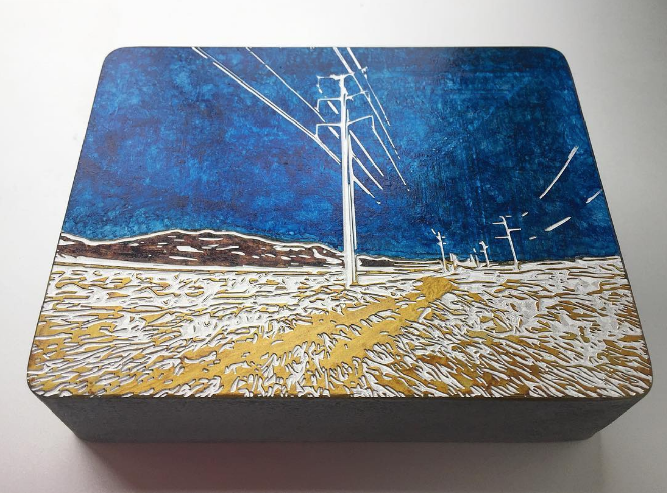 Highway scene engraved by Eddie Serratos.