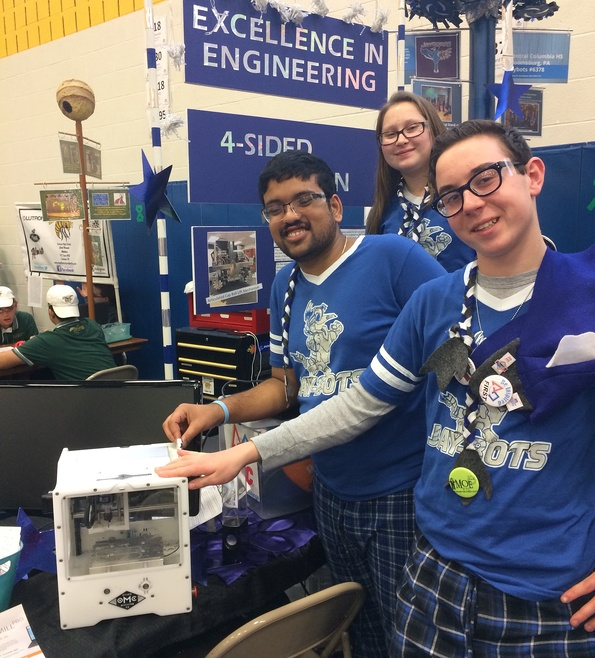 The Jaybots are striking a pose with the Bantam Tools Desktop PCB Milling Machine (formerly called the Othermill).