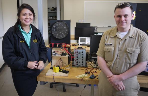 Cal Maritime students using the Bantam Tools Desktop PCB Milling Machine to make a clocks.