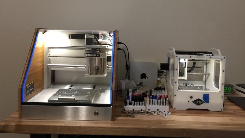 Ed's mini desktop factory includes an Othermill (aka the Bantam Tools Desktop PCB Milling Machine).