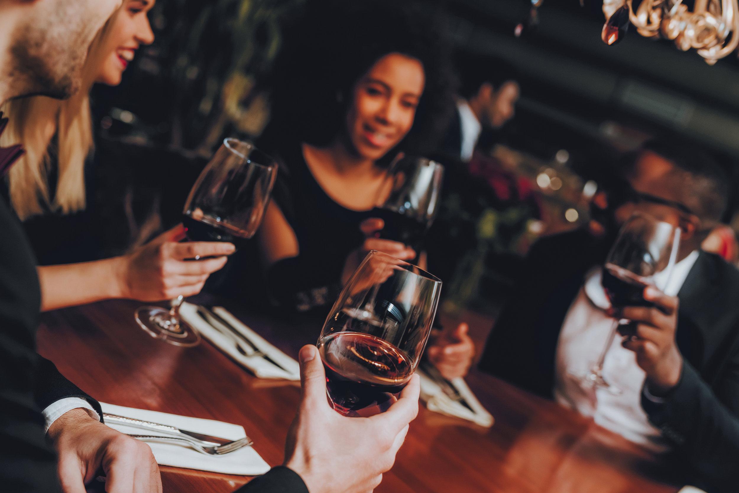 Members enjoying welcome cocktails.jpeg