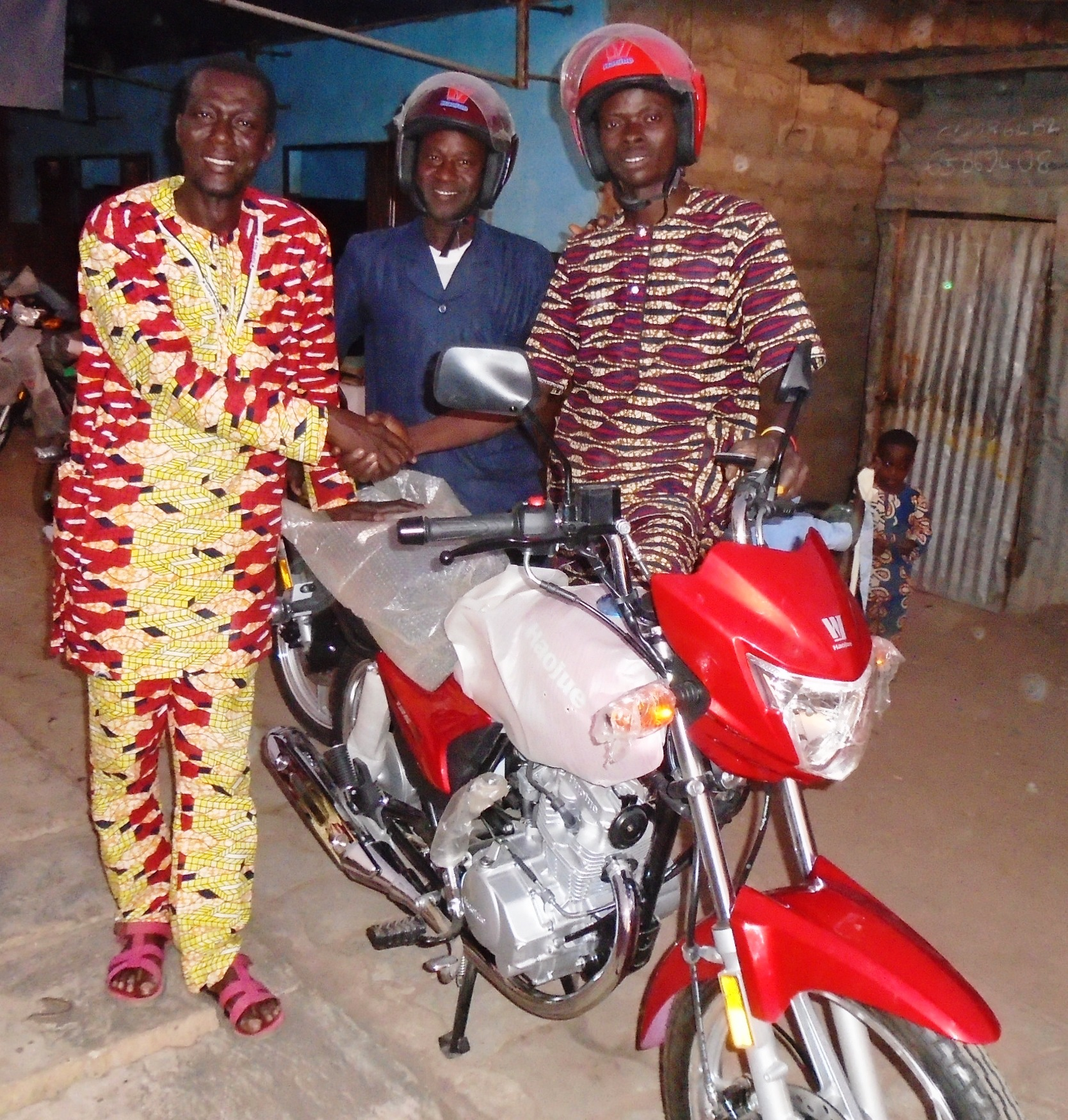 Pastor Pierre Agani Rejoicing With  Pastors Saturnine Amadji & Paul Dousoumon on Their Being Presented With New  Motorbikes.JPG