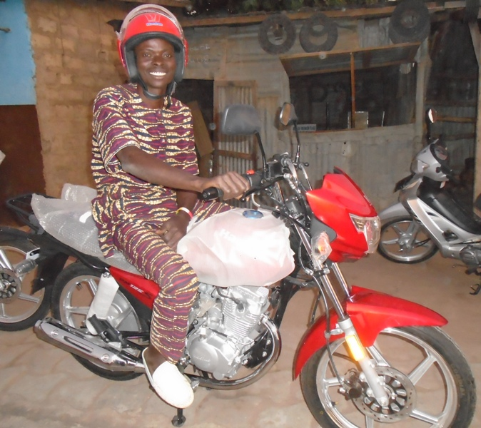 Pastor Paul Dousoumon on His New  Motorbike.JPG