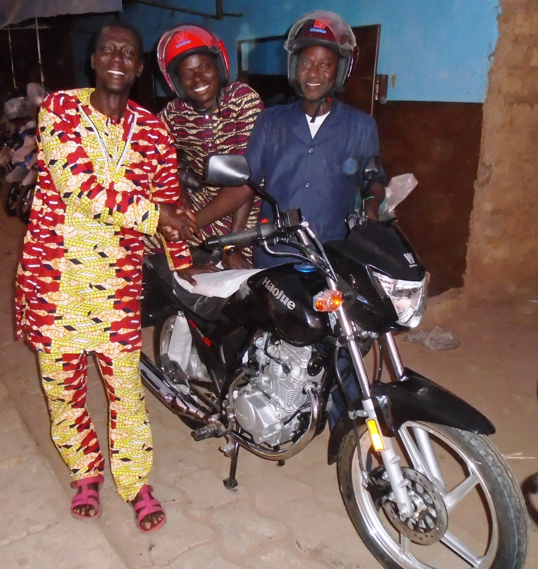 Pastor Pierre Agani Felicitating  With Pastors Saturnine Amadji & Paul Dousoumon on Their Being Presented  With New Motorbikes.JPG