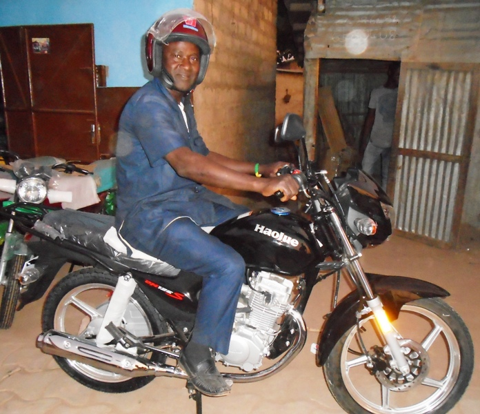 Pastor Saturnine Amadji on His New  Motorbike.JPG