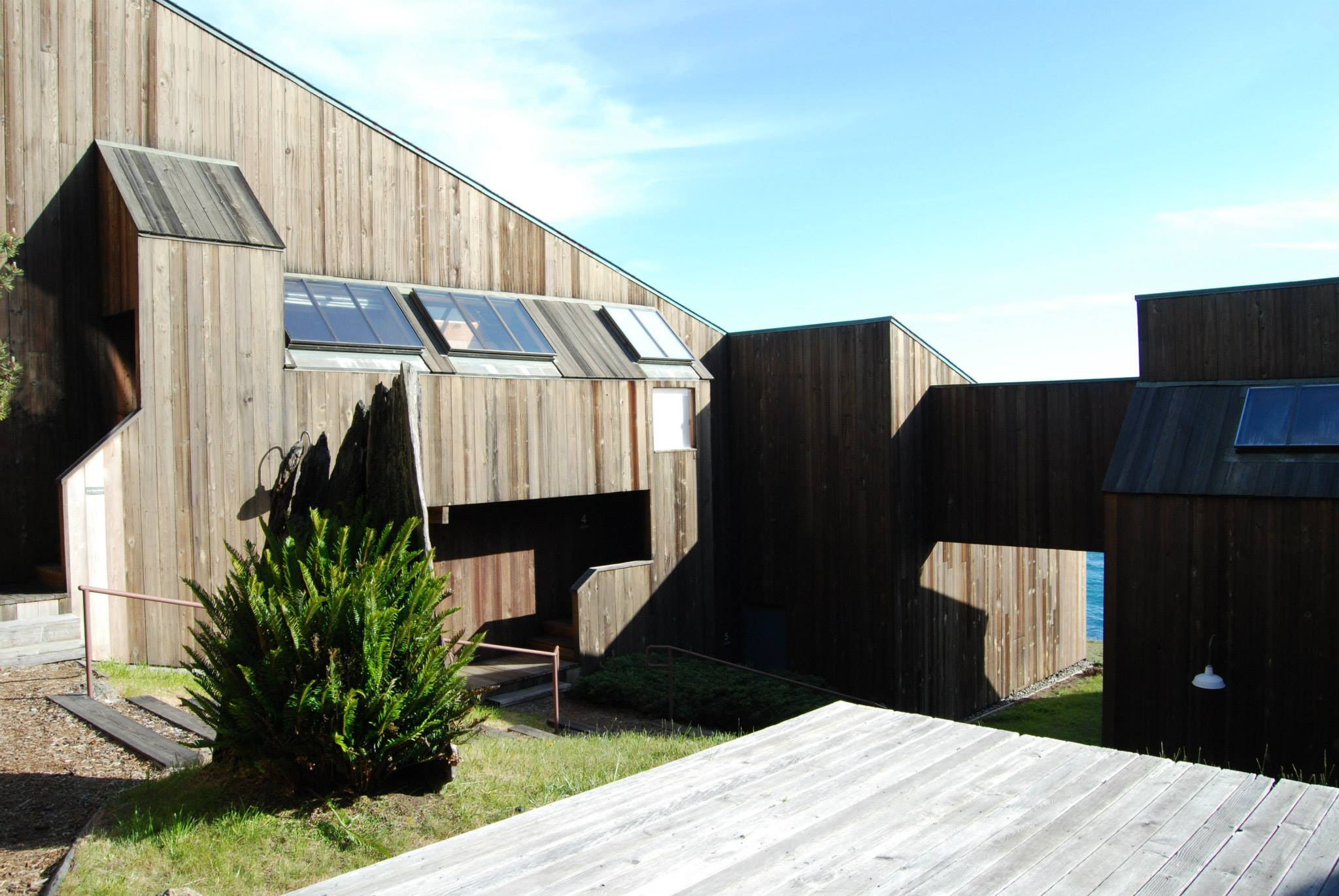 Photo of Sea Ranch buildings with brown weathered siding